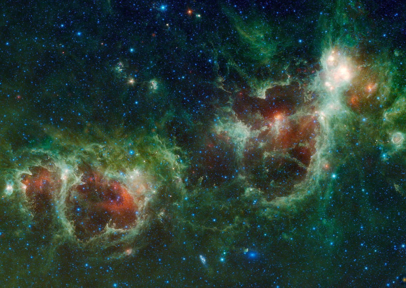 Le nebulose Anima (<i>a sinistra</i>) e Cuore, in un mosaico di immagini nell'infrarosso acquisite dal telescopio spaziale WISE. Cortesia: NASA / JPL-Caltech / UCLA