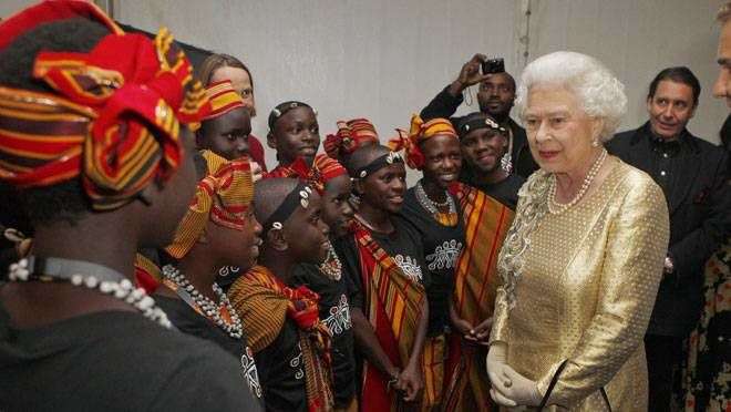 Queen Elizabeth II meets dancers from Kenya backstage, after the Diamond Jubilee Concert performed on a specially erected stage outside Buckingham Palace on June 5th, 2012