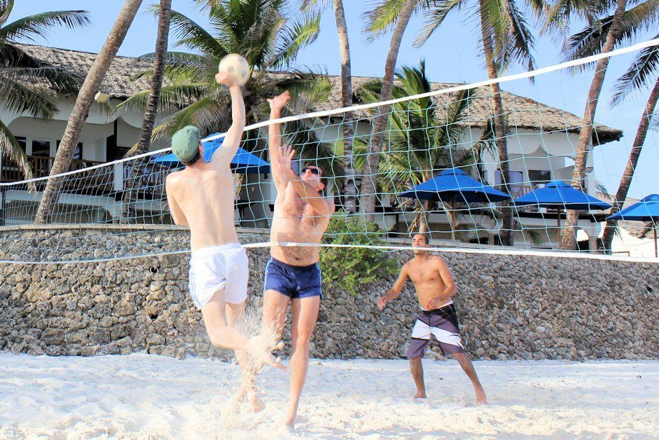 Playing volleyball on the beach