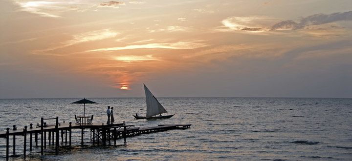 Romantic sundowner at Lake Victoria. Photo credit:  Abercrombie & Kent
