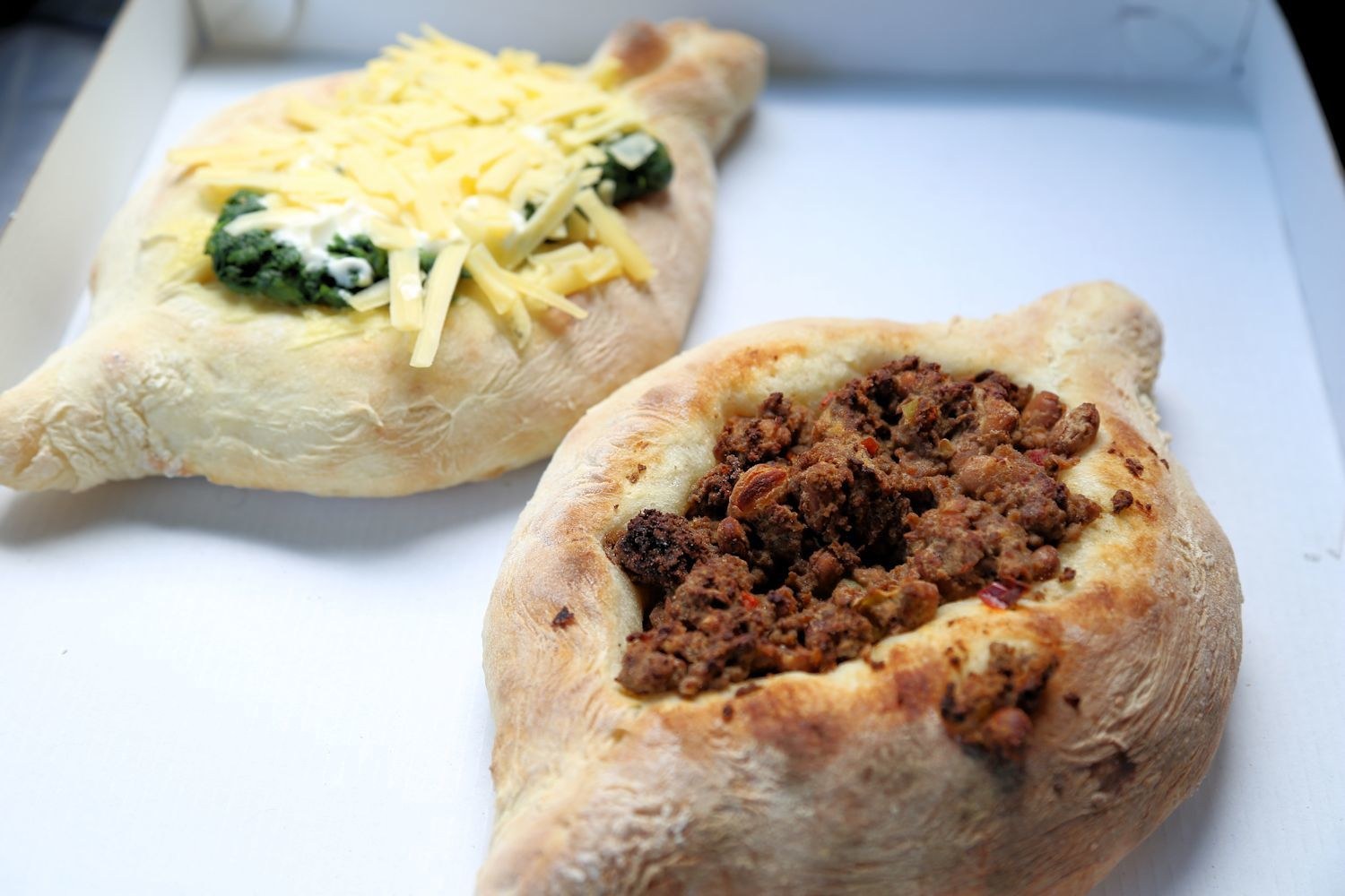 Adjarian Khachapuri with spinach and meat with peas