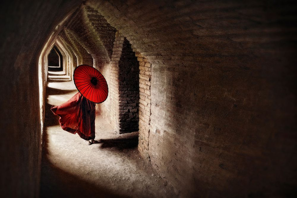 Manuel Librodo/www.tpoty.com Mandalay, Myanmar Monk walking in the hallways of Maha Aungmye Bonzan Monastery.