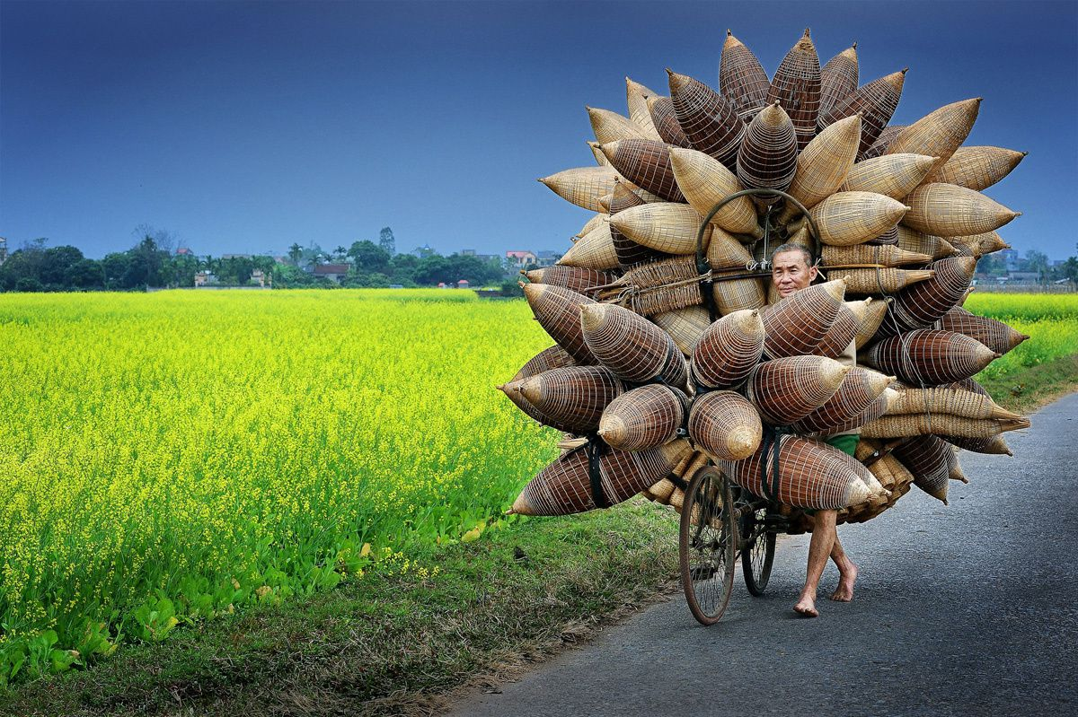 Faces, People, Encounters Special Mention Ly Hoang Long (Vietnam)  Tat Vien village, Hung Yen Province, Vietnam  Man transporting bamboo fishing baskets.