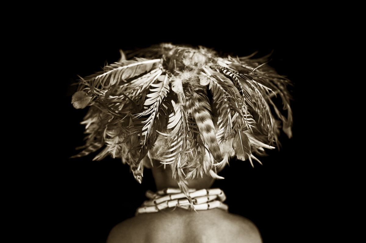 Faces, People, Encounters Commended Stuart Redler (UK)  Simbai, Papua New Guinea  Child wearing feather headdress.