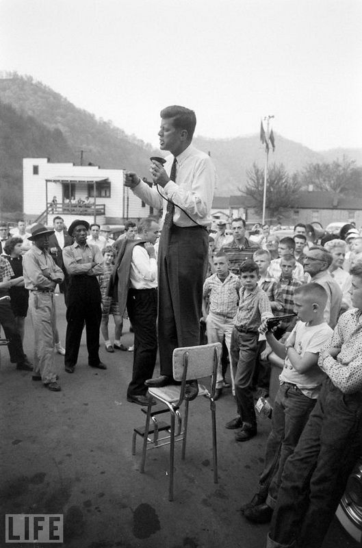 45. Before Camelot, a visit to West Virginia (Before Camelot, a Visit to West Virginia). Photo by Hank Walker, 1960 John F. Kennedy, who will soon become the youngest American president, stands in a small town during the election campaign.
