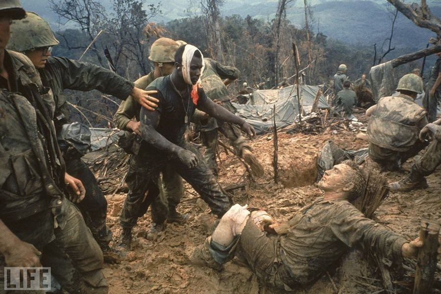 17. Reaching Out: Photo by Larry Burrows, 1966 Marines during the war in Vietnam . The dark-skinned soldier reaches for his wounded comrade white.