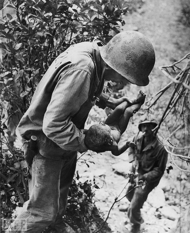 37. Survivor (Littlest Survivor). Photo by W. Eugene Smith, 1943 During World hundreds of Japanese were under siege on the island of Saipan and committed mass suicide rather than surrender to Americans. When U.S. Marines surveyed the island in one of the caves was found barely alive child.