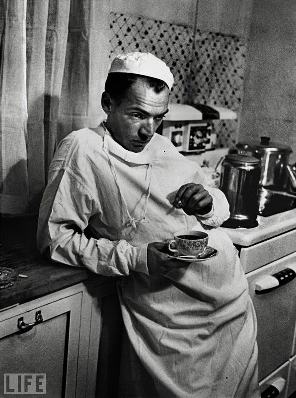 29. Country Doctor (Country Doctor). Photo by W. Eugene Smith, 1948 Country Doctor Ernest Ceriani, the only doctor in the region of 1,200 square miles, after an unsuccessful Caesarean section, in which died due to complications of the mother and child.