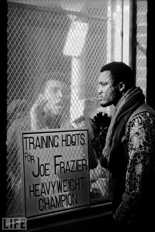 "40. Both Sides Now. Photo by John Shearer, 1971 Muhammad Ali liked to taunt opponents before the fight. Before the ""battle age"" with Joe Frazier in March '71 he questioned his masculinity, intelligence and ""black skin."""