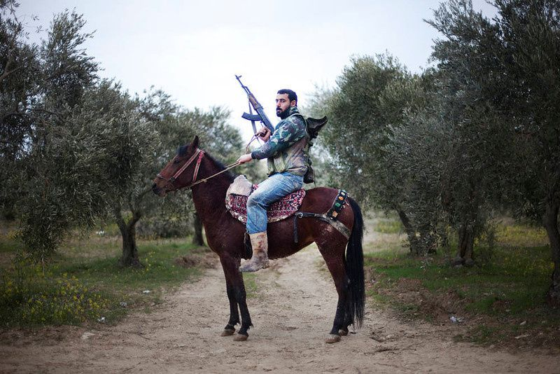 66/ A portrait of a Free Syrian Army rebel mounted of his steed in Al-Shatouria village near to the Turkish border in northwestern Syria, on March 16, 2012, a year after a revolt against President Bashar al-Assad's regime erupted. AFP PHOTO/GIOGOS Moutafis/AFP/Getty Images