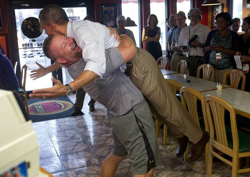 99/ US President Barack Obama is picked up by Scott Van Duzer, owner of Big Apple Pizza and Pasta Italian Restaurant during a visit to the restaurant in Fort Pierce, Florida, September 9, 2012, during the second day of a 2-day bus tour across Florida. AFP PHOTO / Saul LOEB/AFP/Getty Images