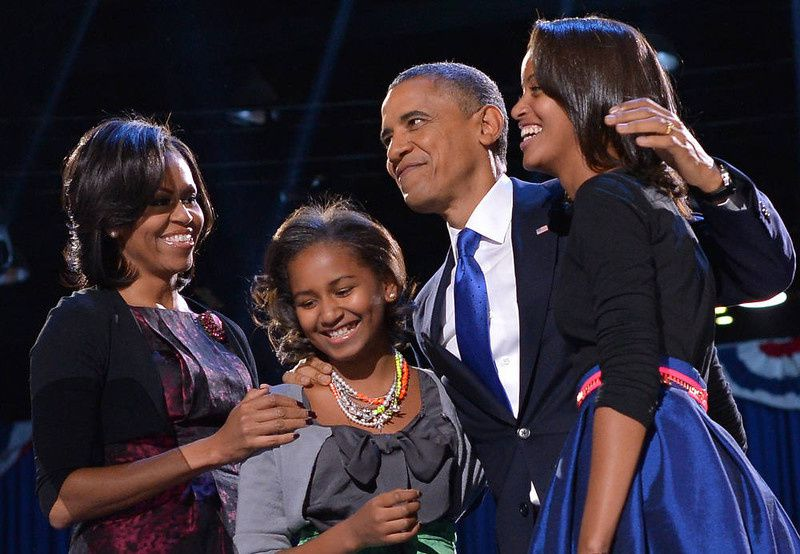54/ US President Barack Obama accompanied by (from L-R ) First Lady Michelle and daughters Sasha and Malia appears on stage on election night November 6, 2012 in Chicago, Illinois. President Barack Obama swept to re-election Tuesday, forging history again by transcending a slow economic recovery and the high unemployment which haunted his first term to beat Republican Mitt Romney. AFP PHOTO/Jewel SAMAD/AFP/Getty Images