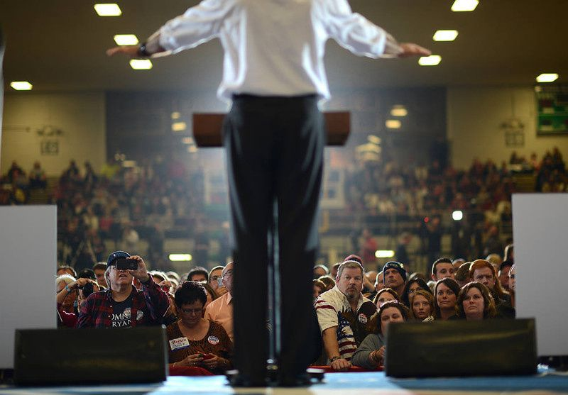 70/ Supporters listen to US Republican Presidential candidate Mitt Romney during a rally at the Veterans Memorial Coliseum in Marion, Ohio, October 28, 2012. AFP PHOTO/Emmanuel DUNAND/AFP/Getty Images