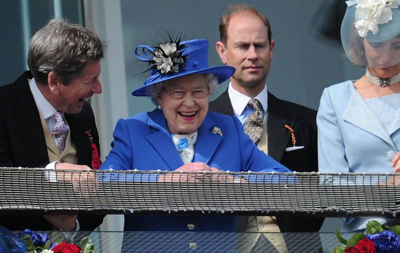 73/ Britain's Queen Elizabeth II (C) standing next to Prince Edward, Earl of Wessex (2R) smiles from the royal balcony as she looks down on the winning horse in the Derby race on Derby Day, the second day of the Epsom Derby horse racing festival, at Epsom in Surrey, southern England, on June 2, 2012 the first official day of Britain's Queen Elizabeth II's Diamond Jubilee celebrations. AFP PHOTO / CARL COURT/AFP/Getty Images