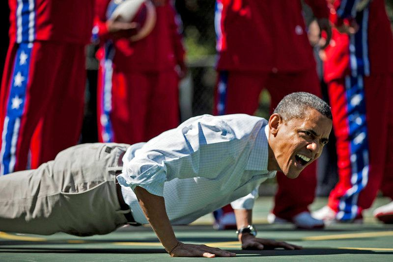 6/ US President Barack Obama does pushups during backetball shooting drills during the annual Easter Egg Roll on the South Lawn of the White House April 9, 2012 in Washington, DC. The First Family participated in the yearly event where the South Lawn is opened up to guests to participate in various egg rolls and other activities. AFP PHOTO/Brendan SMIALOWSKI/AFP/Getty Images