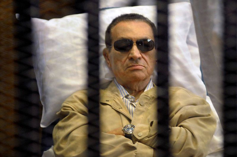 76/ Ousted Egyptian president Hosni Mubarak sits inside a cage in a courtroom during his verdict hearing in Cairo on June 2, 2012. A judge sentenced Mubarak to life in prison after convicting him of involvement in the murder of protesters during the uprising that ousted him last year. AFP PHOTO/STRSTR/AFP/Getty Images