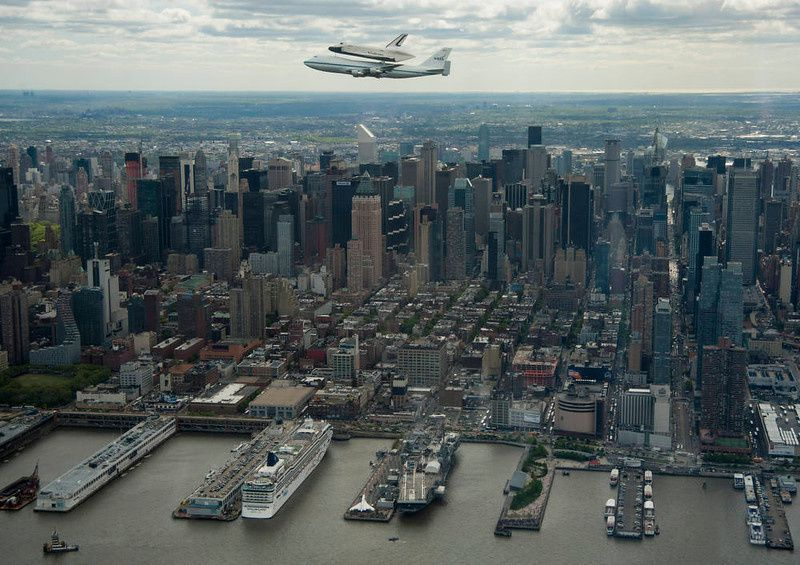 74/ This photo provided by NASA shows space shuttle Enterprise, mounted atop a NASA 747 Shuttle Carrier Aircraft (SCA), flying near the Intrepid Sea, Air and Space Museum on April 27, 2012, in New York. Enterprise was the first shuttle orbiter built for NASA performing test flights in the atmosphere and was incapable of spaceflight. Originally housed at the Smithsonian's Steven F. Udvar-Hazy Center, Enterprise will be demated from the SCA and placed on a barge that will eventually be moved by tugboat up the Hudson River to the Intrepid Sea, Air and Space Museum in June. AFP PHOTO/NASA/Robert Markowitz/HO /AFP/Getty Images