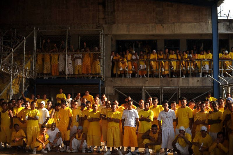 59/ Members of the Mara 18 gang, attend a mass at the Izalco Penitenciary in the city of Izalco, 70 Km west of San Salvador on April 13, 2012. Catholic priest Fabio Colindres, negotiator of the Catholic church, celebrated a mass to thank for the truce between the gangs Mara 18 and Mara Salvatrucha, to down murder rates in El Salvador. AFP PHOTO/Jose CABEZAS/AFP/Getty Images