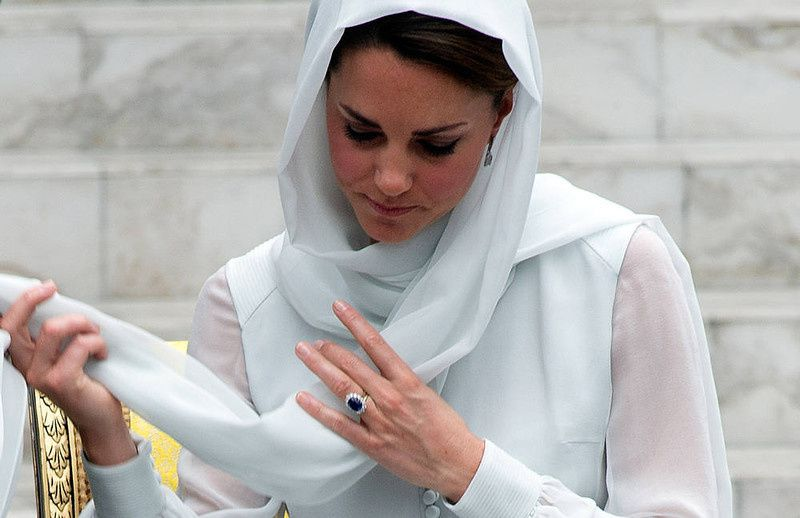 98/ Britain's Prince William's wife Catherine, the Duchess of Cambridge adjusts her scarf outside a mosque at KLCC in Kuala Lumpur on September 14, 2012, on the second leg of a nine-day Southeast Asian and Pacific tour marking Queen Elizabeth II's Diamond Jubilee. AFP PHOTO / Saeed KHAN/AFP/Getty Images