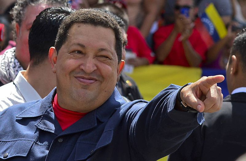 84/ Venezuelan President Hugo Chavez gestures before voting in Caracas on October 07, 2012. Venezuelans voted Sunday with President Hugo Chavez's 14-year socialist revolution on the line as the leftist leader faced youthful rival Henrique Capriles in his toughest electoral challenge yet. AFP PHOTO/Luis ACOSTA/AFP/Getty Images