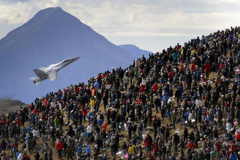 12/ A crowd watches an F/A-18 Hornet fighter aircraft of the Swiss Air Force on October 11, 2012 doing a flight demonstration of the Swiss Air Force over Axalp in the Bernese Oberland. AFP PHOTO / FABRICE COFFRINI/AFP/Getty Images