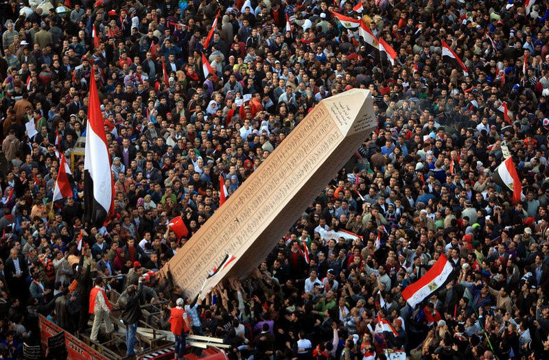 32/ Egyptian protesters carry an obelisk with the names of those killed during last year's uprising, at a huge rally in Tahrir Square on January 25, 2012, marking the first anniversary of the uprising that toppled president Hosni Mubarak as a debate raged over whether the rally was a celebration or a second push for change. AFP PHOTO/MAHMUD HAMS/AFP/Getty Images