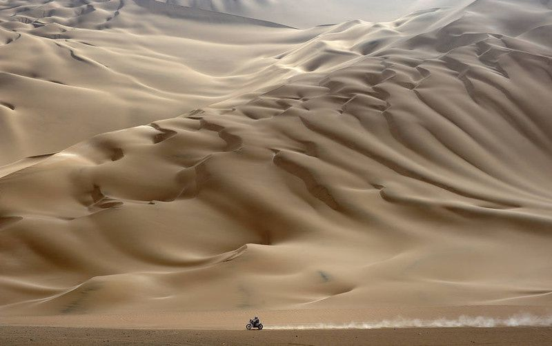 37/  A lonesome motorcyclist rides across the desert during the stage 11 of the Dakar 2012, between Arica and Arequipa, Chile, on January 12, 2012. French Cyril Despres won stage 11. AFP PHOTO/PHILIPPE DESMAZES/AFP/Getty Images