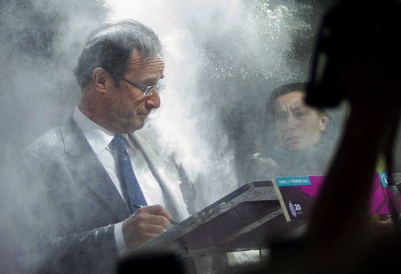 17/ France's opposition Socialist Party (PS) candidate for the 2012 French presidential election Francois Hollande (C) receives flour, thrown by a woman (R) while he was signing a pact on French housing crisis with representatives of the Abbé Pierre Foundation on February 1, 2012 in Paris. AFP PHOTO / FRED DUFOUR/AFP/Getty Images