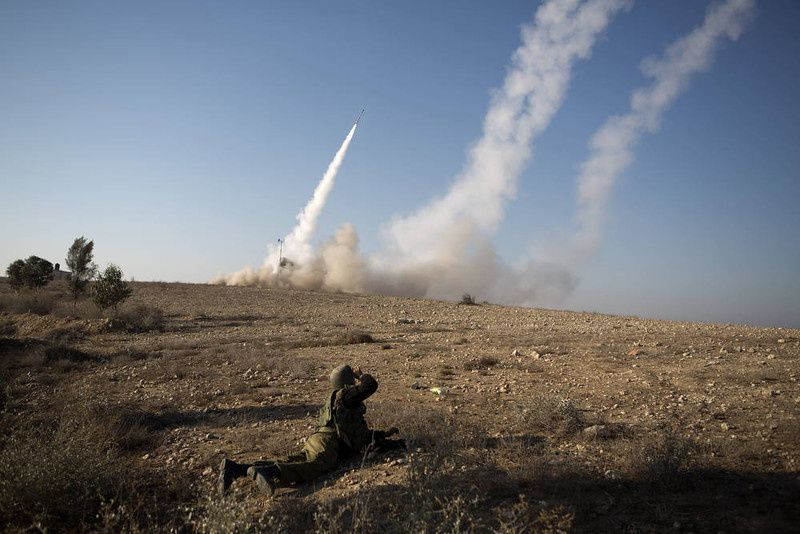 36/ The Israeli military launch a missile from the Iron Dome air defence system, designed to intercept and destroy incoming short-range rockets and artillery shells, in the southern city of Beer Sheva following the firing of rockets from the Gaza Strip on November 15, 2012. Rockets were launched from Gaza into Israel amid a vast Israeli operation against Gaza militants which began on November 14 with the killing of a top Hamas chief along with ten other Palestinians. AFP PHOTO/MENAHEM KAHANA/AFP/Getty Images