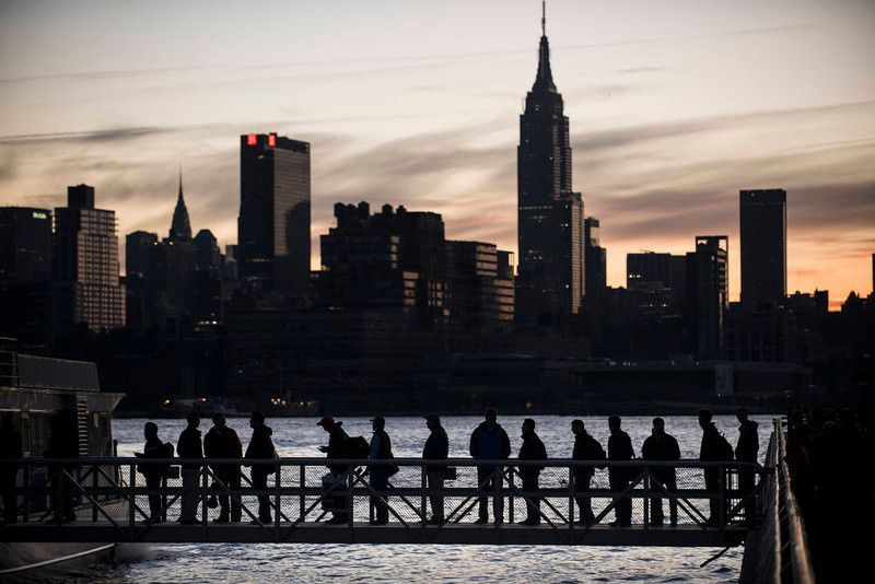 56/ People board the NY Waterways ferry with the Manhattan skyline in the background November 1, 2012 in Hoboken, New Jersey. Hurricane Sandy, which made landfall along the New Jersey shore, left parts of the state and the surrounding area without power including much of lower Manhattan south of 34th Street. AFP PHOTO/Brendan SMIALOWSKI/AFP/Getty Images