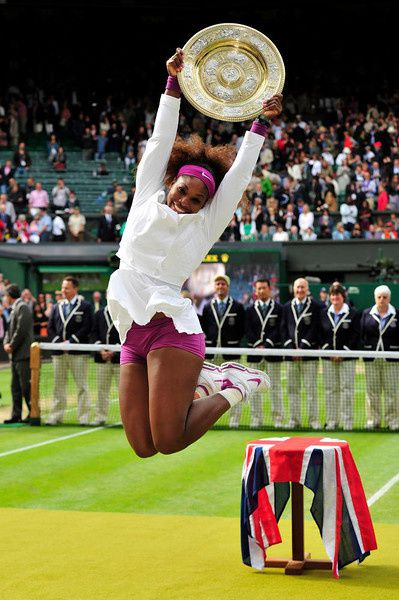 53/ US player Serena Williams celebrates with the trophy, the Venus Rosewater Dish after her women's singles final victory over Poland's Agnieszka Radwanska on day 12 of the 2012 Wimbledon Championships tennis tournament at the All England Tennis Club in Wimbledon, southwest London, on July 7, 2012. Serena Williams won the match 6-1, 5-7, 6-2. AFP PHOTO/ GLYN KIRK /AFP/Getty Images