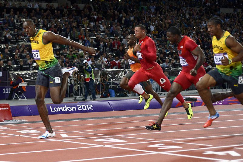 20/ Jamaica's Usain Bolt wins the men's 100m final at the athletics event during the London 2012 Olympic Games on August 5, 2012 in London. AFP PHOTO / ADRIAN DENNIS/AFP/Getty Images