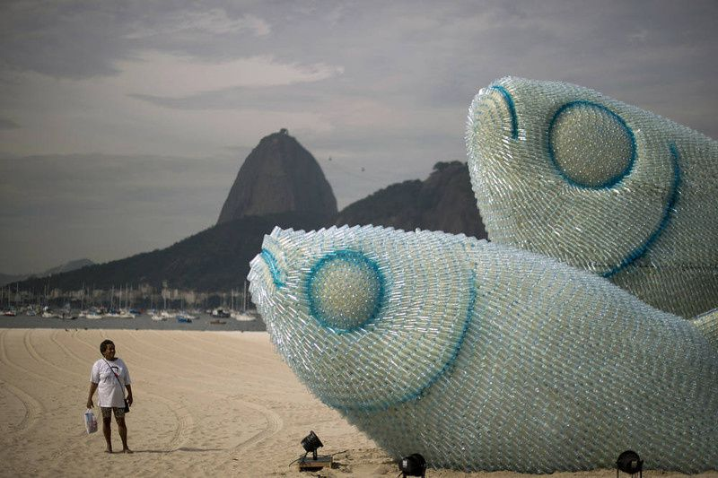 52/ A woman looks at an installation made of recycled plastic bottles representing fishes, in Botafogo beach, in Rio de Janeiro, on June 19, 2012, in the sidelines of the UN Conference on Sustainable Development, Rio+20. The UN conference, which marks the 20th anniversary of the Earth Summit -- a landmark 1992 gathering that opened the debate on the future of the planet and its resources -- is the largest ever organized, with 50,000 delegates. AFP PHOTO / Christophe SIMON/AFP/Getty Images