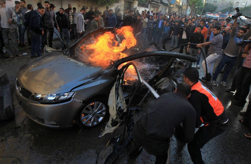 41/ Palestinians extinguish fire from the car of Ahmed Jaabari, head of the military wing of the Hamas movement, the Ezzedin Qassam Brigades, after it was hit by an Israeli air strike in Gaza City on November 14, 2012. The top Hamas commander Ahmed al-Jaabari was killed in an Israeli air strike , medics and a Hamas source told . AFP PHOTO/MAHMUD HAMS/AFP/Getty Images