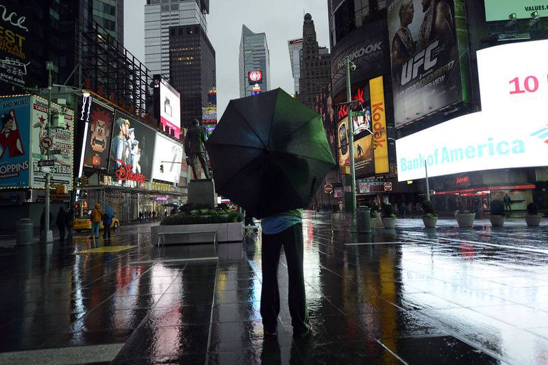 "57/ A lone tourist stands in Times Square early October 29, 2012 as New Yorkers prepare for Hurricane Sandy which is supposed to hit the city later tonight Much of the eastern United States was in lockdown mode October 29, 2012 awaiting the arrival of a hurricane dubbed ""Frankenstorm"" that threatened to wreak havoc on the area with storm surges, driving rain and devastating winds. AFP PHOTO / TIMOTHY A. CLARY/AFP/Getty Images"