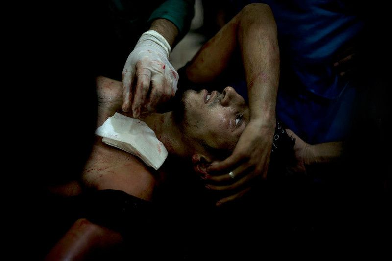 86/ A rebel fighter is brought to the Dar al-Shifa hospital in the northern city of Aleppo to be treated for his wounds on October 1, 2012, as fighting in Syria's second largest city between rebel forces and government troops continues. AFP PHOTO/ZAC BAILLIE/AFP/Getty Images