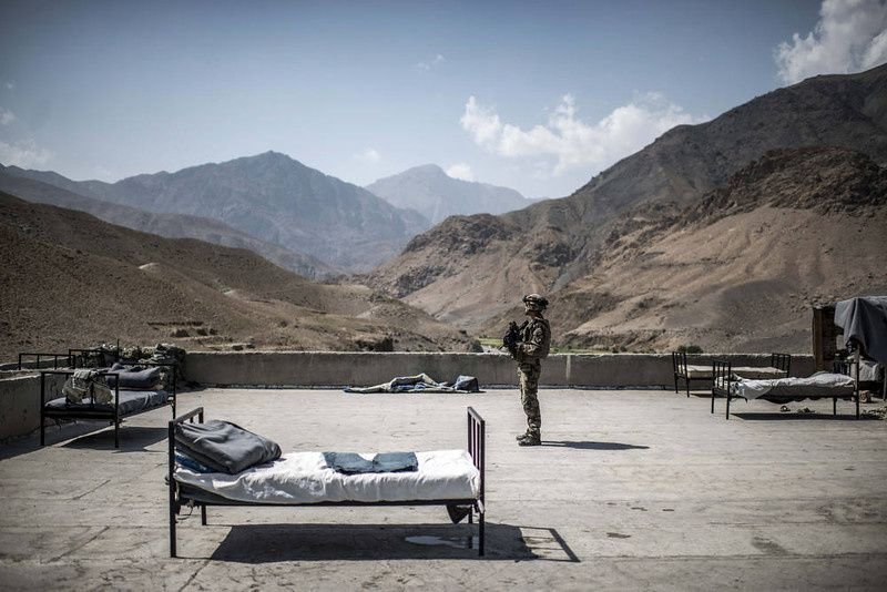 91/ A French soldier stands on a rooftop of an Afghan National Police (ANP) combat post on September 24, 2012, in a village on the road to Naghlu the French army base. Beds are used by the policemen to sleep outside due to the heat. France is the fifth largest contributor to NATO's International Security Assistance Force (ISAF), which is due to pull out the vast majority of its 130,000 troops by the end of 2014. AFP PHOTO / JEFF PACHOUD/AFP/Getty Images