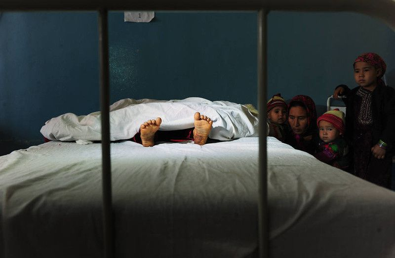 49/ The family of a five year old Afghan girl, that was allegedly raped by a 22 year old man, looks on as she lies in a hospital bed in Kaldar district of Balk Province of Mazar-i-Sharif on November 12, 2012. The alleged rapist and neighbor was later detained by police. There is little sign that violence against women in Afghanistan is decreasing, despite billions of dollars of international aid which has poured into the country during the decade-long war. Some 87 percent of Afghan women report having experienced physical, sexual or psychological violence or forced marriage, according to figures quoted in an October report by the British charity Oxfam. AFP PHOTO/ Qais USYAN/AFP/Getty Images
