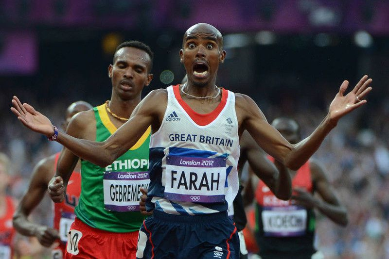 33/ Britain's Mohamed Farah celebrates after winning the men's 5000m final at the athletics event of the London 2012 Olympic Games on August 11, 2012 in London. AFP PHOTO / OLIVIER MORIN/AFP/Getty Images