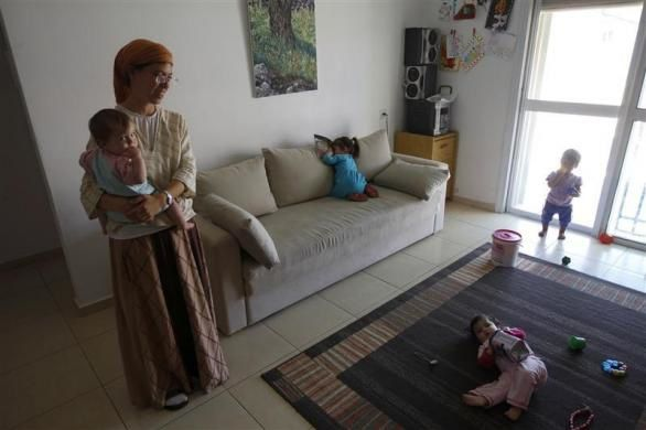 Jewish Hagit Sagiv holds her child at their home in one of five buildings that Israel's Supreme Court ruled had been illegally built in the Ulpana neighbourhood of the Beit El area near the West Bank city of Ramallah June 4, 2012.  REUTERS/Ronen Zvulun
