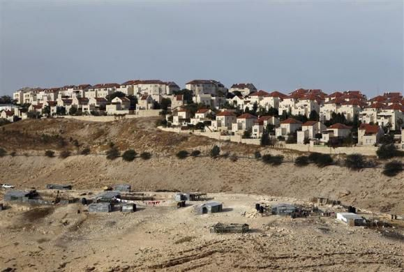 A Bedouin encampment of the Jahalin tribe is seen in front of the Jewish yichouv of Maale Adumim, near Jerusalem December 3, 2012.