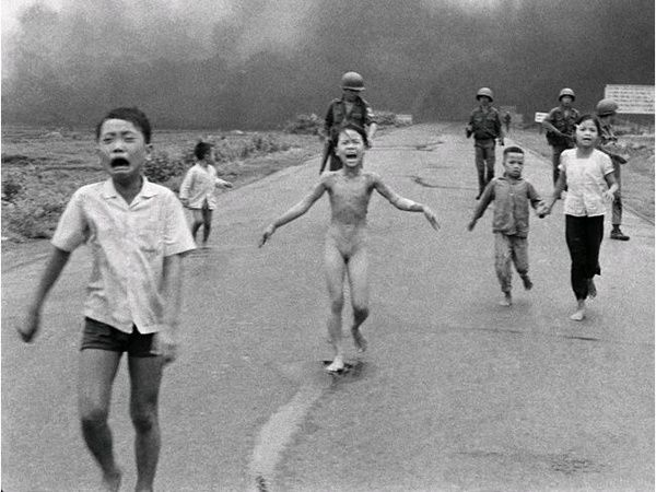 "Kim Phuc, also known as ""the napalm girl"" from the Pulitzer Prize winning photograph, 40 years later with her newborn boy. (imgur.com)"