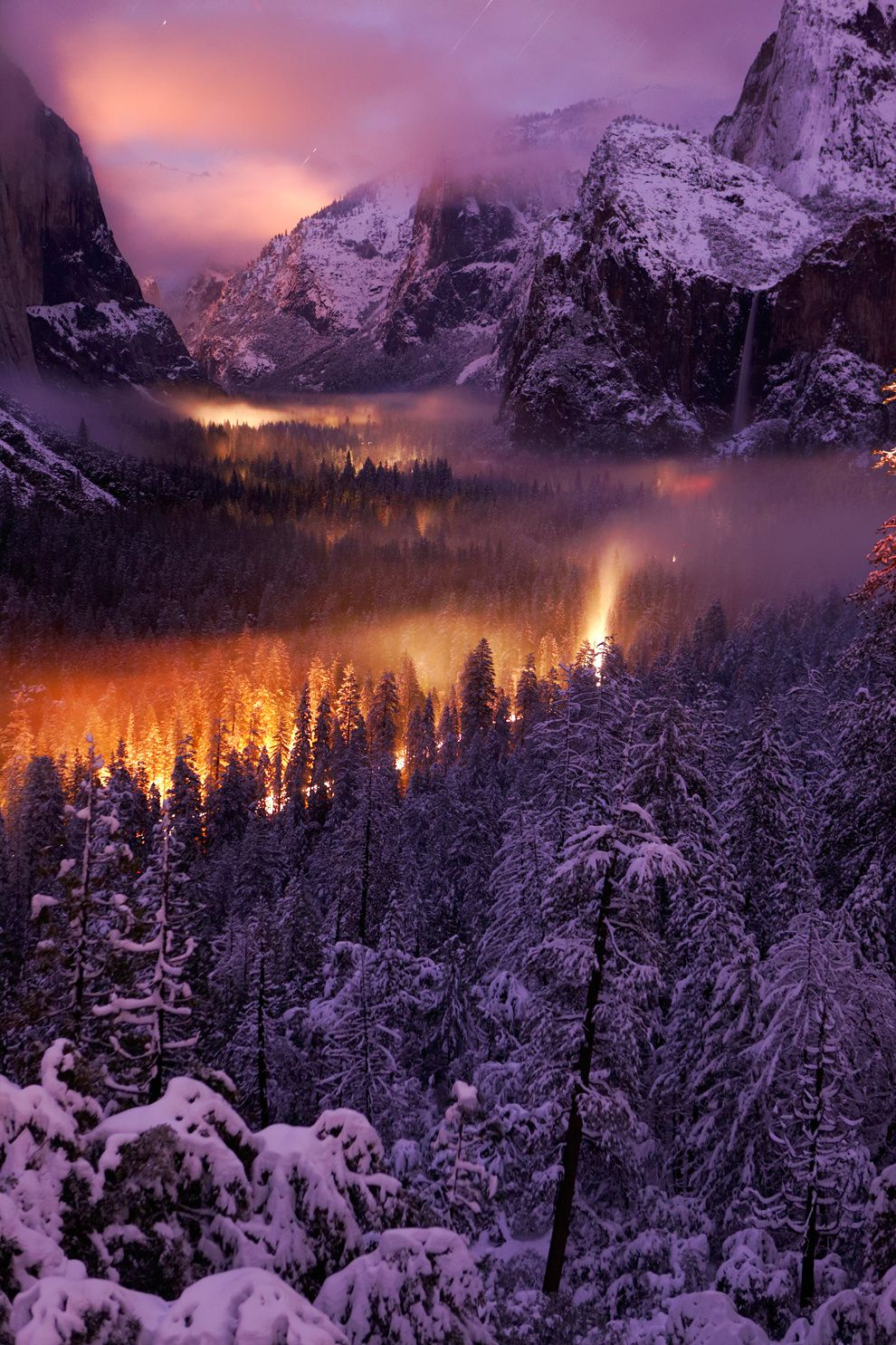 "17. ""Yosemite Valley at night."" Car headlights illuminate the mist that spreads over the valley. Yosemite National Park, USA. (Phil Hawkins / National Geographic Traveler Photo Contest)"