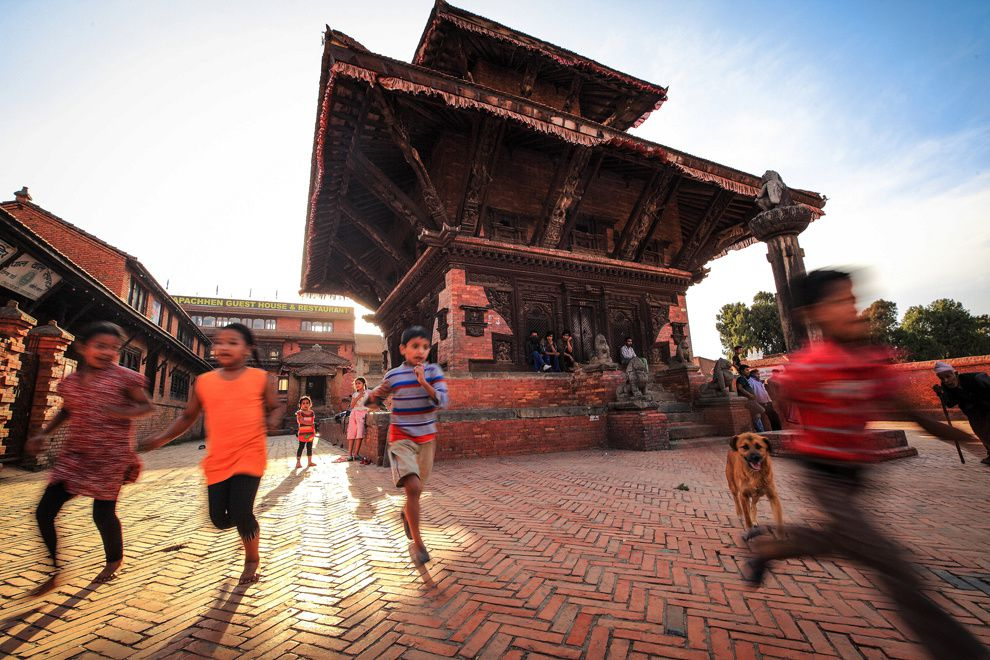 "39. ""Nepal, do not stop."" Children play in Bhaktapur, Nepal. (Mac Kwan / National Geographic Traveler Photo Contest)"