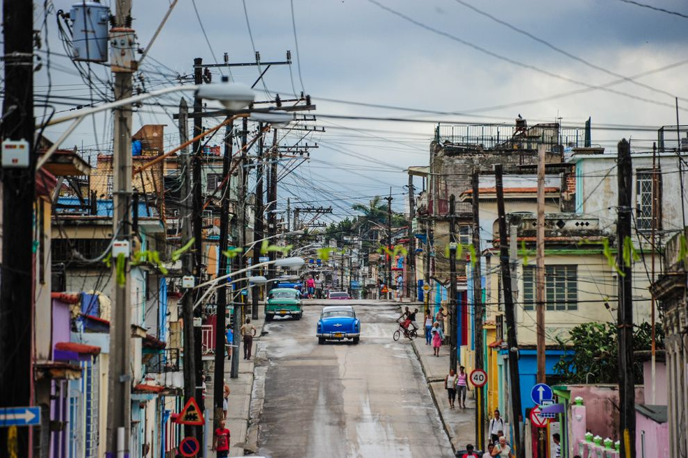 "40. ""Regla, Havana, Cuba."" In February 2013 I visited Photoworkshop in Havana, and wandered in the suburb of Regla. My attention was drawn to the numerous wires and old cars. This can only be seen in Cuba. (Daniel Ikemiyashiro / National Geographic Traveler Photo Contest)"