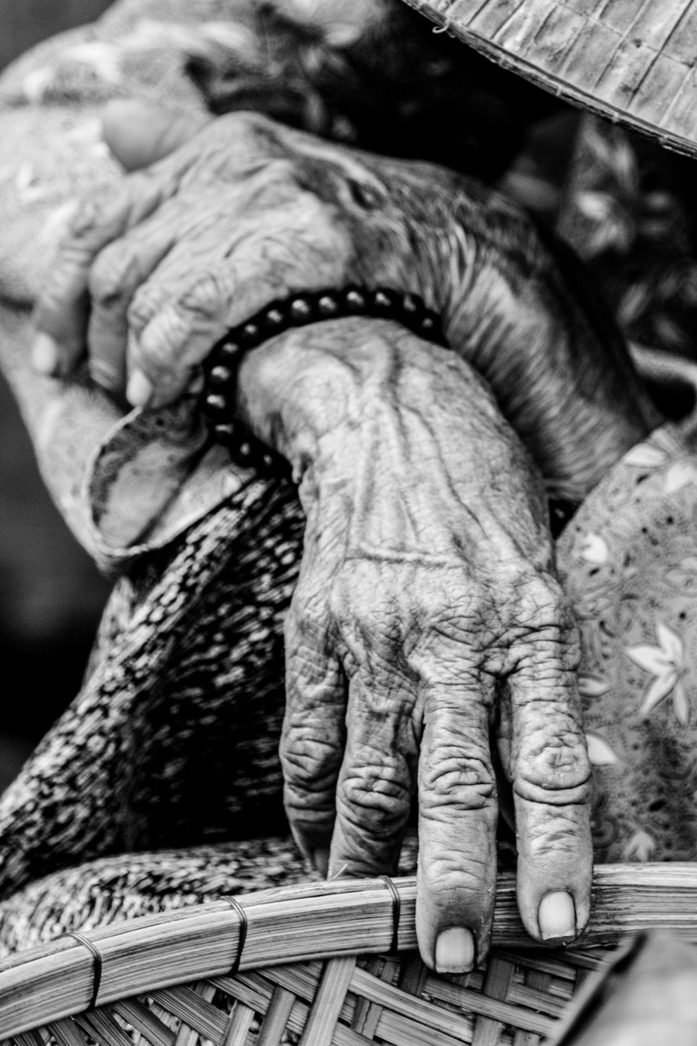 "31. ""Years."" Old Vietnamese sitting by the road in the grocery market in Hoi An, Vietnam. Her beautiful hands eloquently tell of her lived years. (Soren Hansen / National Geographic Traveler Photo Contest)"