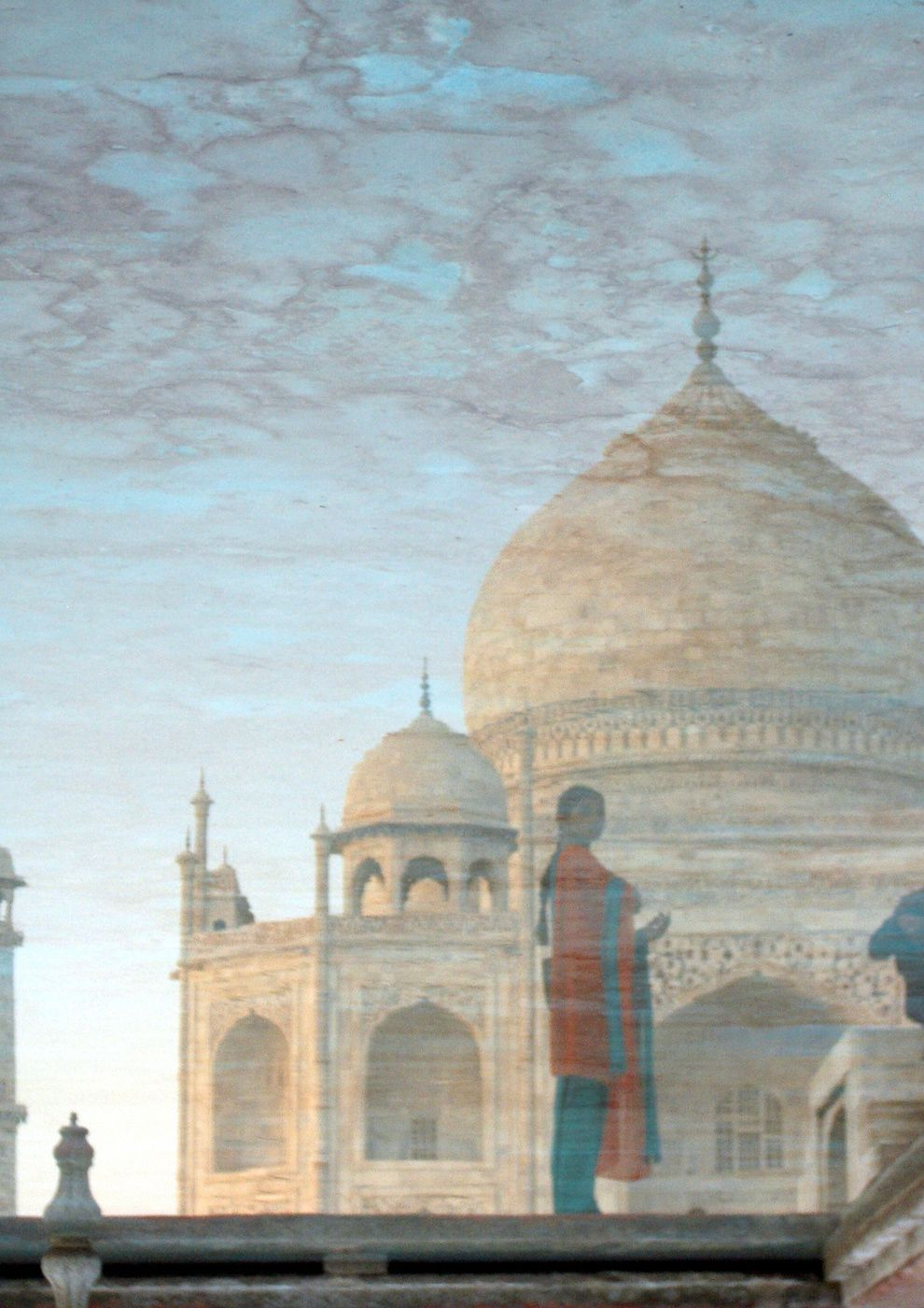 "27. ""Reflection of the Taj Mahal."" Reflection of a woman and the Taj Mahal. Agra, India. (Degrey Phillips / National Geographic Traveler Photo Contest)"