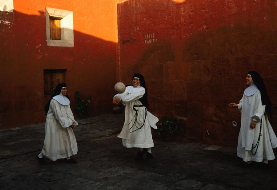 Novice nuns play ball at the Santa Catalina Monestary in Arequipa, Peru, 1998. (Credit M. Farlow NATIONAL GEOGRAPHIC)