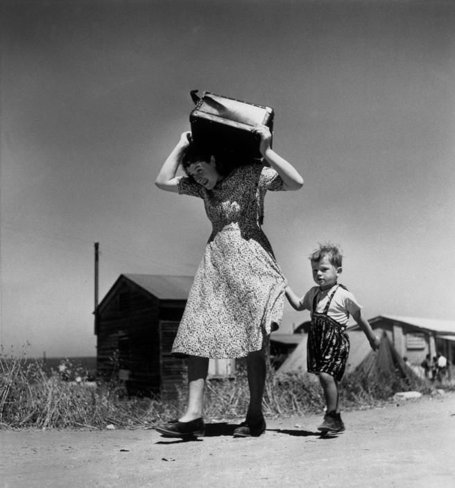 ISRAEL. Haifa. 1949-50. Woman carrying luggage accompanied by a small boy.