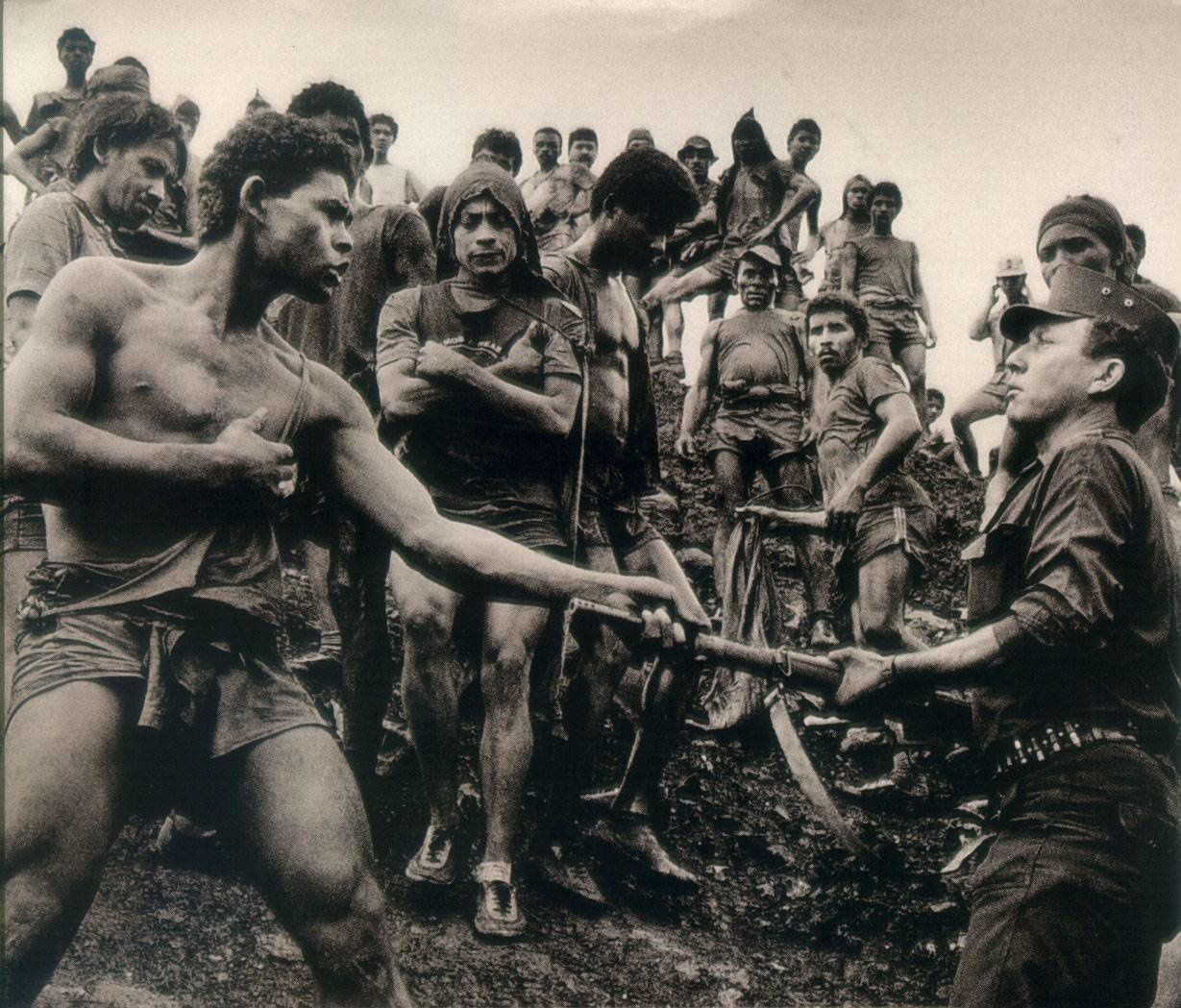 Pelada gold mine workers and military police Brazil 1986 (Photo Sebastiao Salgado)